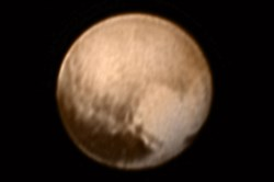 Pluto is pictured in this July 7, 2015 image from New Horizons Long Range Reconnaissance Imager (LORRI). The image has been combined with lower-resolution color information from the Ralph instrument.