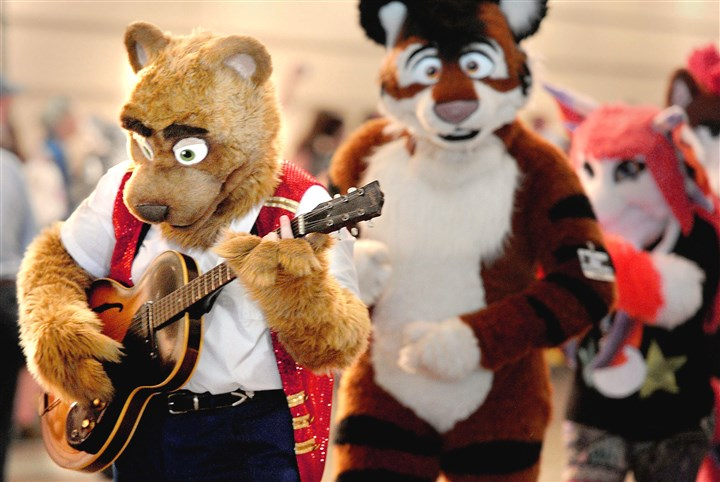 20150711ppFurries2LOCAL-1 Flurries play to the crowd during the Fursuit Walk along the 10th Street underpass of the David L. Lawrence Convention Center during the Anthrocon convention Saturday, July 11, 2015. (Pam Panchak/Post-Gazette)