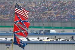 The U.S. and Confederate flags are seen flying over the infield during the NASCAR Sprint Cup Series Quaker State 400 at Kentucky Speedway on Saturday in Sparta, Ky.