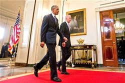President Barack Obama walks Tuesday with Vice President Joe Biden after delivering remarks in the East Room of the White House in Washington after reaching a deal with Iran over its nuclear program.