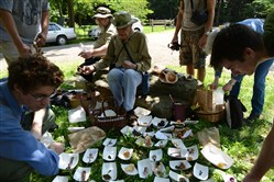 Seated background, from left, La Monte Yarroll, a mycologist for the Western Pennsylvania Mushroom Club, and Dick Dougall an identifier for the club, organize the cataloging of mushrooms found on a two-hour club-sponsored mushroom walk in Salamander Park in Fox Chapel.