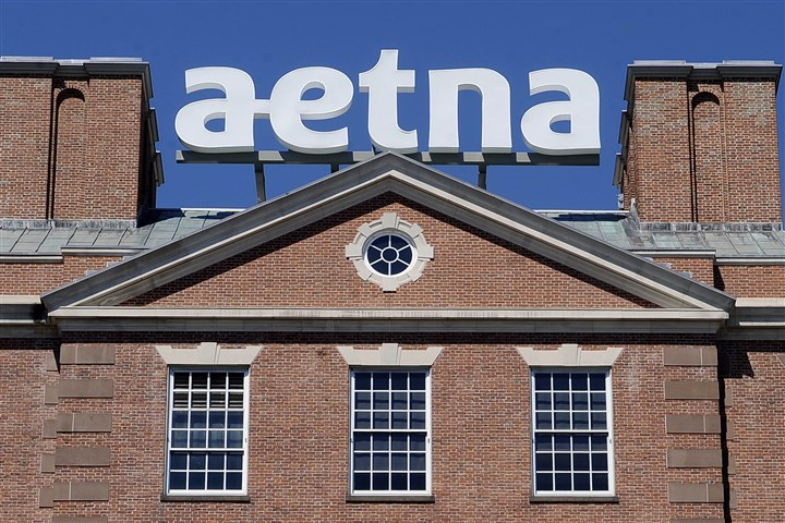Aetna HQ logo A sign for Aetna Inc., sits atop a building at the company headquarters in in Hartford, Conn. Health insurer Aetna Inc. has agreed to buy competitor Humana Inc. in a $37 billion deal the companies say would create the second-largest managed care company.