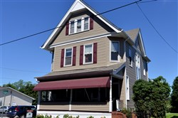 The renovations to the Victorian home in Derry included installing new vinyl siding, new shutters and a new roof.