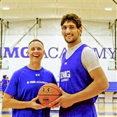 John Mahoney, a former coach at Our Lady of the Sacred Heart High School in Moon, is now working at IMG Academy in Florida. He's posing with Satnam Singh, only 19, who became the first player from India ever selected in the NBA draft. Singh is 7 feet 2.