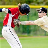 Monroeville's Angelo Saccamango tags out Shaler's Alex Ficorilli in recent American Legion baseball action.