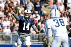 Penn State quarterback Christian Hackenberg passes during the first quarter of the Blue-White spring game at Beaver Stadium. The school announced it will go back to the tradition of not displaying the names of the players on the back of the jerseys.