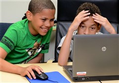 "David Mims, left, a fourth-grader at Propel Homestead, and Branden Panell, a fifth-grader at Woodland Hills Academy, work on a digital manipulation project Friday during one of many workshops held at the National Energy Technology Laboratory ""My Brother's Keeper Day at the Lab"" event. About 100 minority students from Pittsburgh regional, middle and high schools participated in the daylong event."