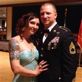 Erik Shaw and his wife Kristen.  The couple married via live video satellite feed in 2005 after Mr. Shaw feared he would be killed in combat in Southern Baghdad.  Just days earlier, he suffered a traumatic brain injury during a roadside improvised explosive device attack.