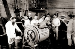 Students taking the ice cream short course at then-Pennsylvania State College in 1894 work to separate cream at the dairy barns.