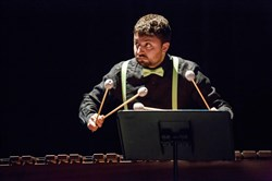 "Percussionist Ian Rosenbaum plays a marimba during PNME's production of ""The Gray Cat and the Flounder"" in July 2015."