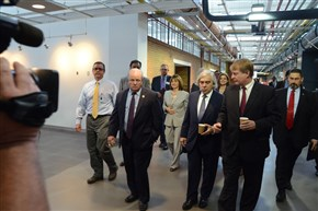 Last July, Energy Secretary Ernest Moniz toured the Energy Innovation Center in the Lower Hill District. The tour marked the beginning of a partnership between the DOE and the city to help Pittsburgh shift away from relying on faraway power sources Left to right, Rep. Mike Doyle, Mr. Moniz, Allegheny County Chief Executive Rich Fitzgerald.