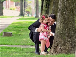 Steven D'Achille's plays with his daughter Adriana in Bloomfield's Friendship Park in 2015. Mr. D'Achille's wife, Alexis, committed suicide after suffering from postpartum depression after the birth of their first child.