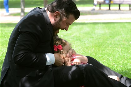 Steven D'Achille plays with his daughter, Adriana, in Friendship Park in Bloomfield. Mr. D'Achille's wife, Alexis, committed suicide after suffering from postpartum depression after the birth of their child.