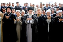 Ayatollah Ali Khamenei, center, leads Eid al-Fitr prayers Saturday in Tehran, Iran. Among the senior leaders present is President Hassan Rouhani, far right.