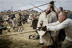 Around 200 people dressed as Vikings simulate a battle during the Viking Festival at Trelleborg, the Viking fortress of King Harald Bluetooth from around year 980 ad, near Slagelse, south-west of Copenhagen, on Friday July 17, 2015.