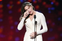 Caitlyn Jenner accepts the Arthur Ashe Courage Award at the ESPY Awards last July. She has a book deal for her memoir, scheduled for release next year.