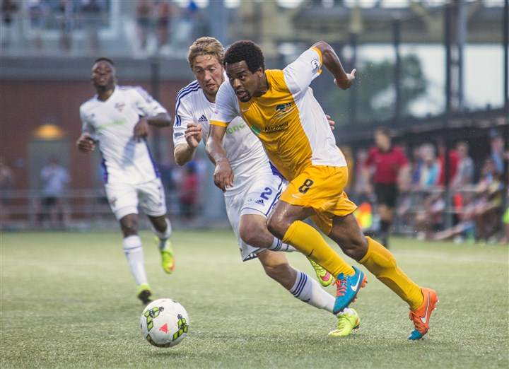 20150718amfRiverhoundsSports260 Riverhounds midfielder Mike Green charges towards the goal during a game against Louisville City F.C. at Highmark Stadium. The Riverhounds have released their schedule for the upcoming season.