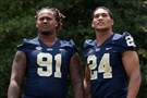 Pitt's Darryl Render and James Conner pose for a picture at the ACC football kickoff Monday in Pinehurst, N.C.