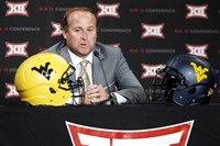 West Virginia head football coach Dana Holgorsen addresses attendees at the NCAA college Big 12 Conference Football Media Days Monday, July 20, 2015, in Dallas.