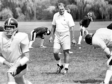 Former Steelers coach Chuck Noll observes his players during training camp in 1975.