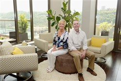 Debbie and Rick Peterson in their First Side condo.