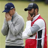 United States' Jordan Spieth, left, and his caddie Michael Greller after finishing the final round at the British Open Golf Championship at the Old Course, St. Andrews, Scotland, Monday, July 20, 2015.