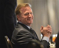 NFL Commissioner Roger Goodell listens to the opening speaker at a fundraising luncheon today for the Washington, Pa. YWCA held in Canonsburg.