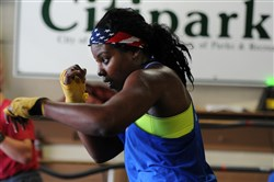 Olympic hopeful Tika Hemingway shadow boxes at the Pittsburgh Boxing Club in Overbrook.