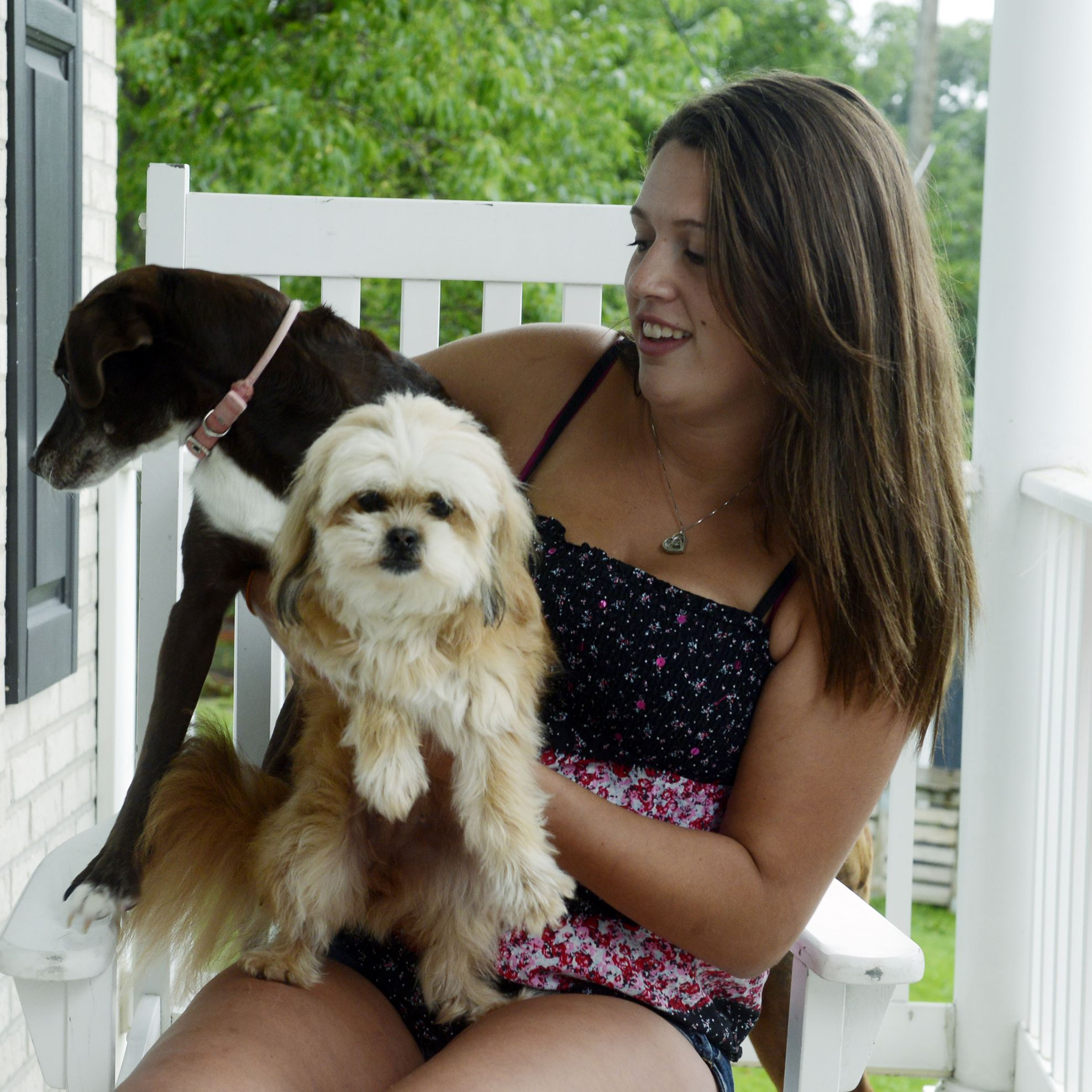 20150721bwCercielloMag03-2 Katelyn Cerciello, 18, of McDonald with a couple of her family's dogs, Gracie, left, and Deliah. Ms. Cerciello posted a story on Facebook and photos about Petland in Robinson, where she had worked and questioned the care the animals were getting.