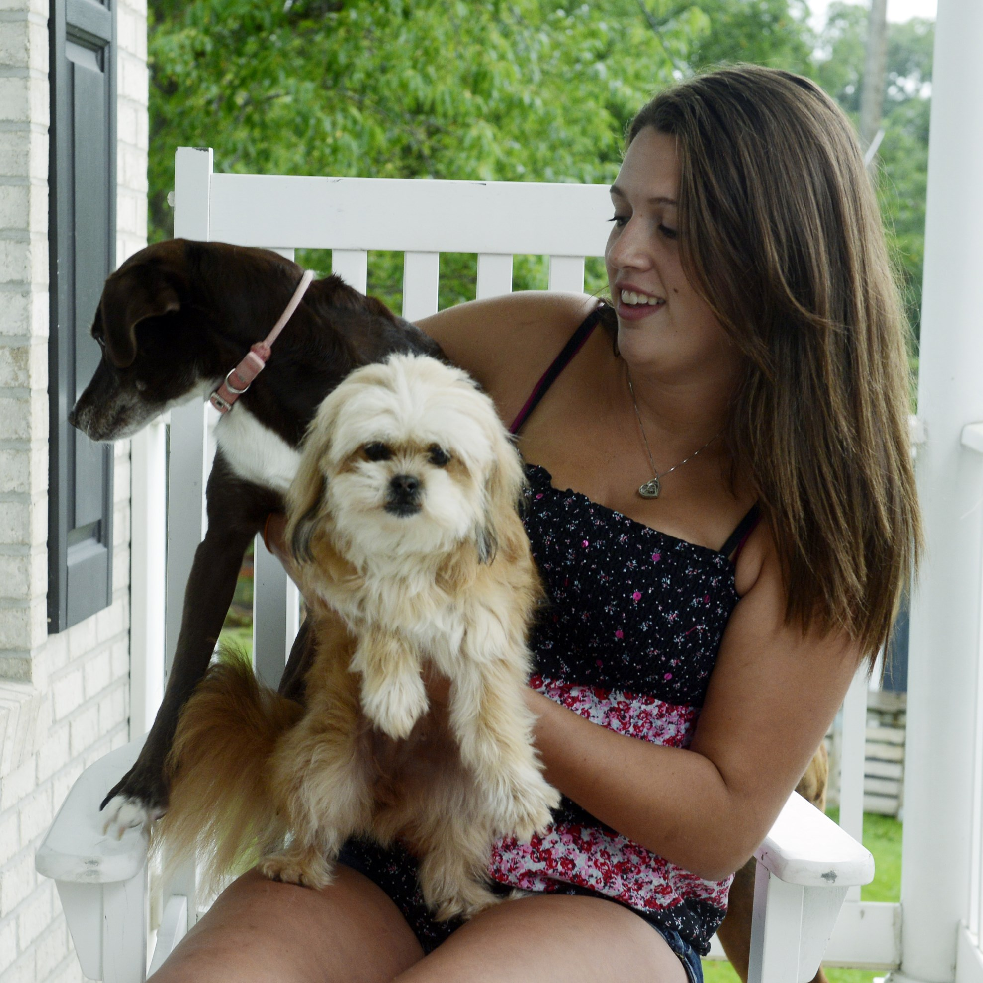 Katelyn Cerciello, 18, of McDonald with a couple of her family's dogs, Gracie, left, and Deliah. Ms. Cerciello posted a story on Facebook and photos about Petland in Robinson, where she had worked and questioned the care the animals were getting.