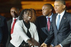 President Barack Obama is greeted by his half-sister Auma on Friday at Kenyatta International Airport in Nairobi, Kenya.