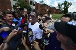 Steelers receiver Antonio Brown center, talks with reporters after he arrives for training camp at St Vincent College in Latrobe, Pa