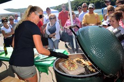 Linkie Marais demonstrates how to cook with the Big Green Egg grill in the seventh annual Big Green Egg festival at Moraine State Park in Portersville.