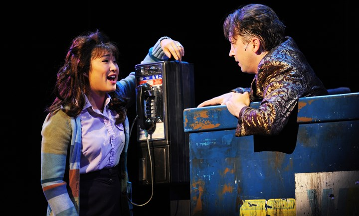 "20150727HOWedding1 Jenna Ushkowitz as Julia lends a hand to down-in-the-dumps J. Michael Zygo as Robbie in the Pittsburgh CLO production of ""The Wedding Singer,"" at the Benedum Center through Aug. 2."