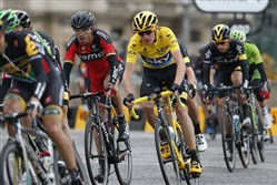 Team Sky rider Chris Froome of Britain, wearing the race leader's yellow jersey, cycles during the final 21st stage of the 102nd Tour de France cycling race from Sevres to Paris Champs-Elysees, France, today.