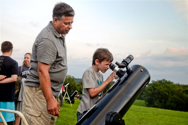 20150724bwStarsMag07-8 Dan Peden of Brookline, left, with Philip Sahady, 7, of Republic, Fayette County, using Mr. Peden's 8-inch refractor telescope at the Amateur Astronomers Association of Pittsburgh's Star Party at Mingo Observatory in Mingo Creek County Park in Washington County