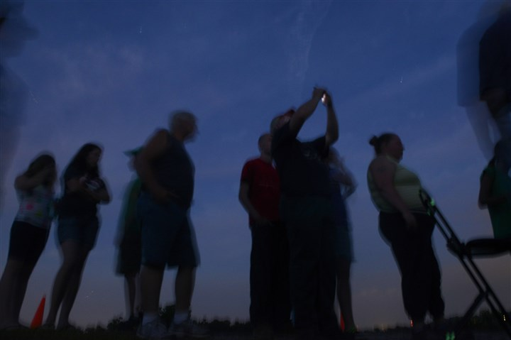 20150724bwStarsMag06-7 People wait in line to look through a telescope at the Amateur Astronomers Association of Pittsburgh's Star Party at Mingo Observatory in Mingo Creek County Park in Washington County