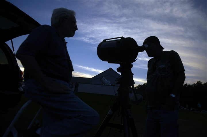 20150724bwStarsMag05-6 Fred Klein of Monroeville, left, with 11-inch reflector mirror telescope at the Amateur Astronomers Association of Pittsburgh's Star Party at Mingo Observatory in Mingo Creek County Park in Washington County.