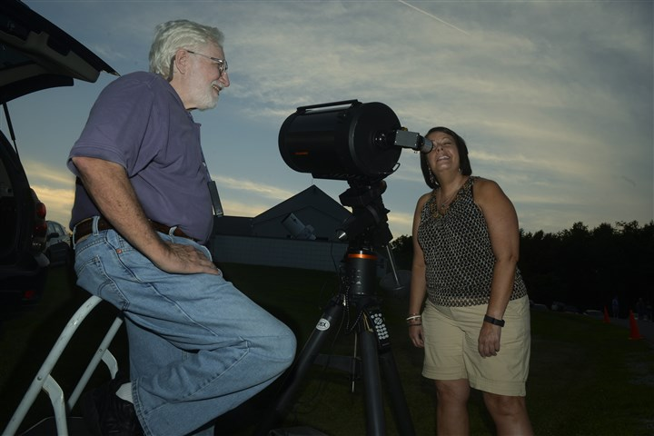 20150724bwStarsMag04-5 Fred Klein of Monroeville with 11-inch reflector mirror telescope, left, and Karen McCurry of Whitehall look at Saturn during the Amateur Astronomers Association of Pittsburgh's Star Party at Mingo Observatory in Mingo Creek County Park in Washington County.