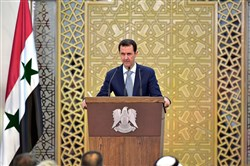 In this photo released by the Syrian official news agency SANA, Syrian President Bashar Assad delivers a speech Sunday in Damascus, Syria.