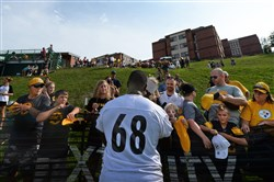 Steelers left tackle Kelvin Beachum signs autographs after workouts Monday at St. Vincent College in Latrobe.
