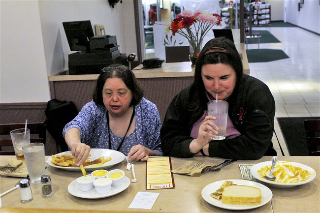 Tic Toc customers enjoy lunch at the restaurant in Macy's on Tuesday. Janice McCready, left, from Murrysville, had fried chicken, while Loralee Babjack from Pittsburgh had the chicken chili.