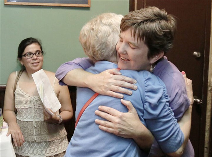 marge winters 07282015 Margie Winters, right, receives a hug after parents meet to discuss her firing at Waldron Mercy Academy in Merion, suburban Philadelphia in July. Ms. Winters was dismissed for being in a same-sex marriage.