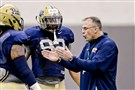 Pitt head coach Pat Narduzzi talks with Rori Blair during a spring practice on the South Side.