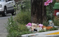 A makeshift memorial marks the scene of Deona Barnett's killing at the corners of Antrim Street and Fleming and Richardson avenues in Brighton Heights.