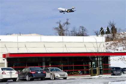 A U.S Airways plane flies past the U.S Airways operations control center in Moon. The last flight to be handled by the Pittsburgh center is set for Aug. 23.