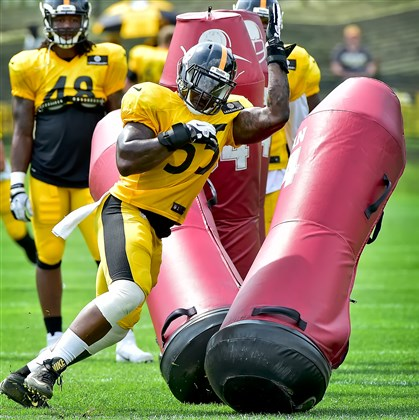 Steelers LB Arthur Moats works on technique during training camp last month at St. Vincent College in Latrobe.