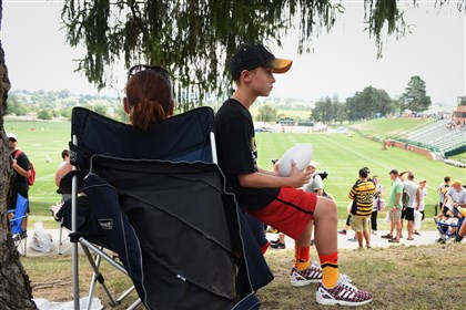 Zach Ballard, 12, of Mt. Washington, Ky., waits for the start of Steelers workouts today at Saint Vincent College. Browse our wide view page for more visuals from in Latrobe.