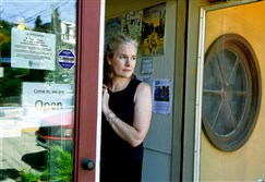 Leslie Clague, a community outreach coordinator, stands at the door to the Polish Hill Civic Association where she is the only staff.