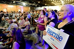 Pia Colucci, right, of Oakland waits for Bernie Sanders to begin speaking during a telecast broadcasted at a meet-up held in Lawrenceville on Wednesday. Supporters of the Democratic presidential hopeful gathered across the country to watch the telecast.